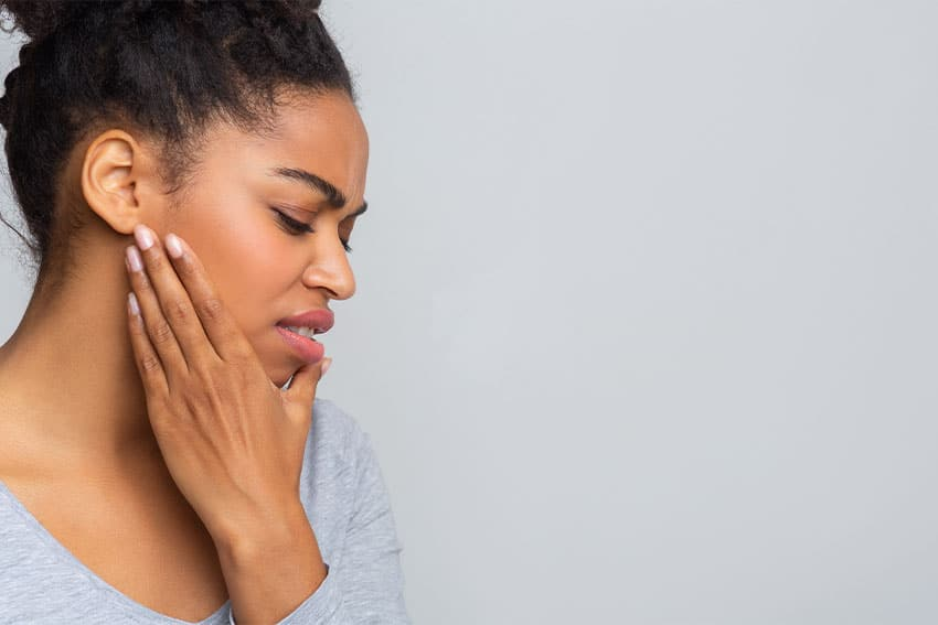 woman suffering from jaw related pain