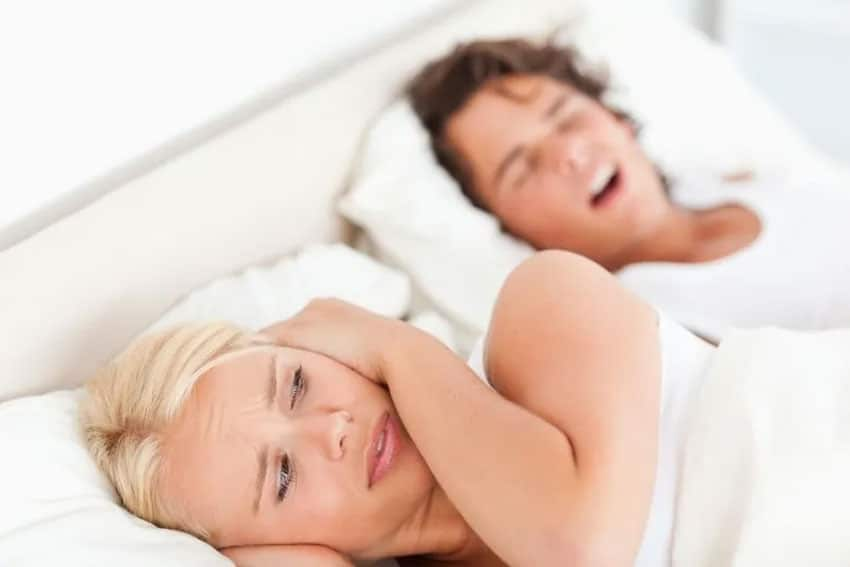 mouth snoring man and irrated woman