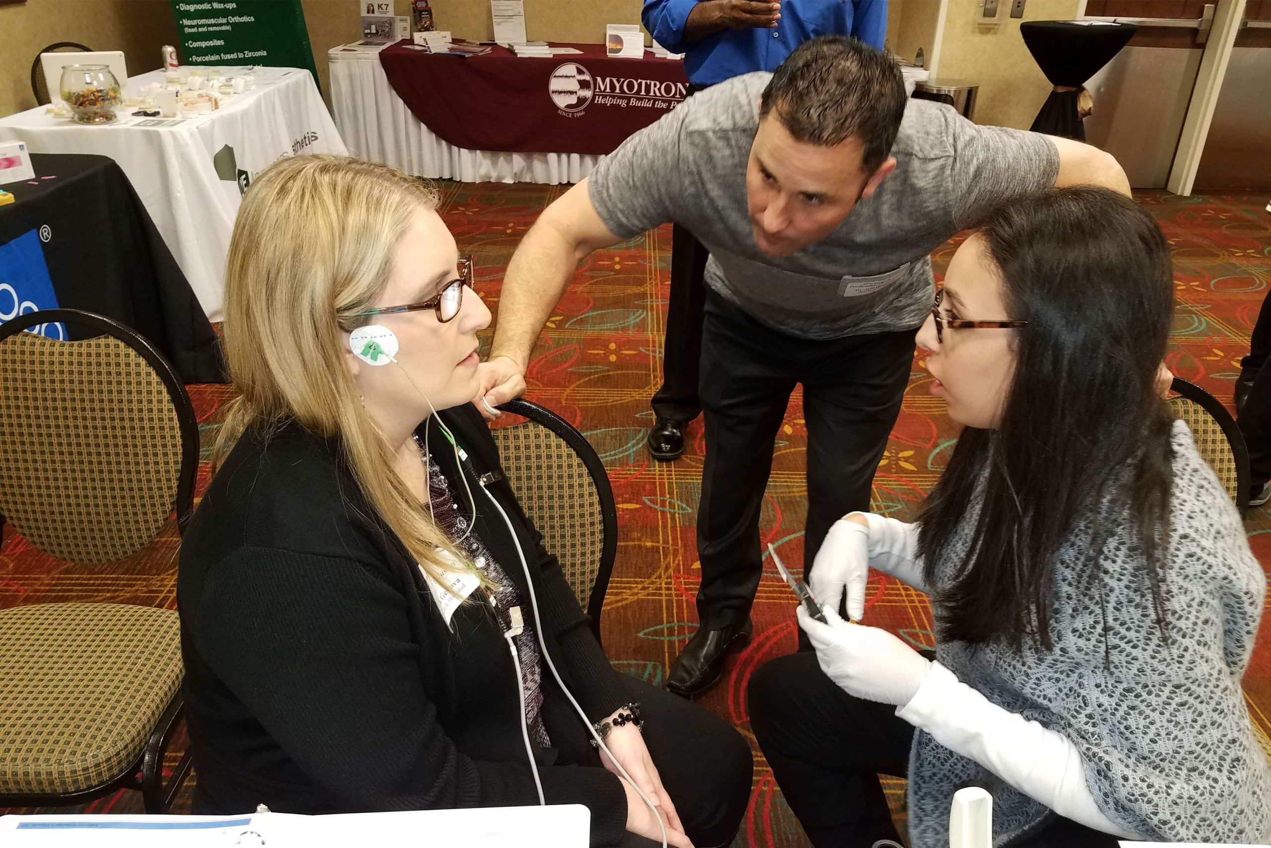 Dentist Dr. Jeff Haddad working with a patient at a sleep & tmj conference