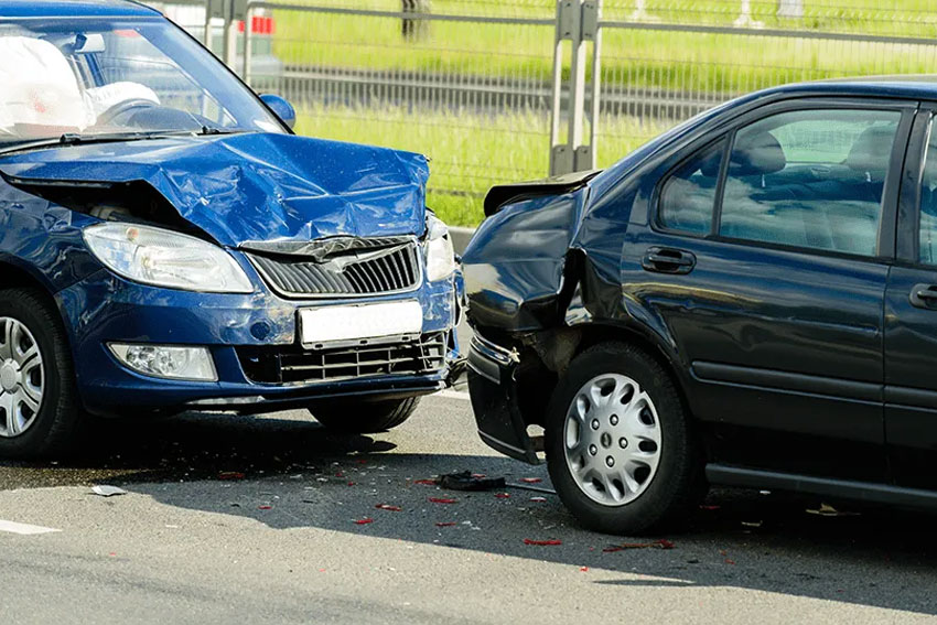 An accident with cars where there is visible damage to both vehicles.