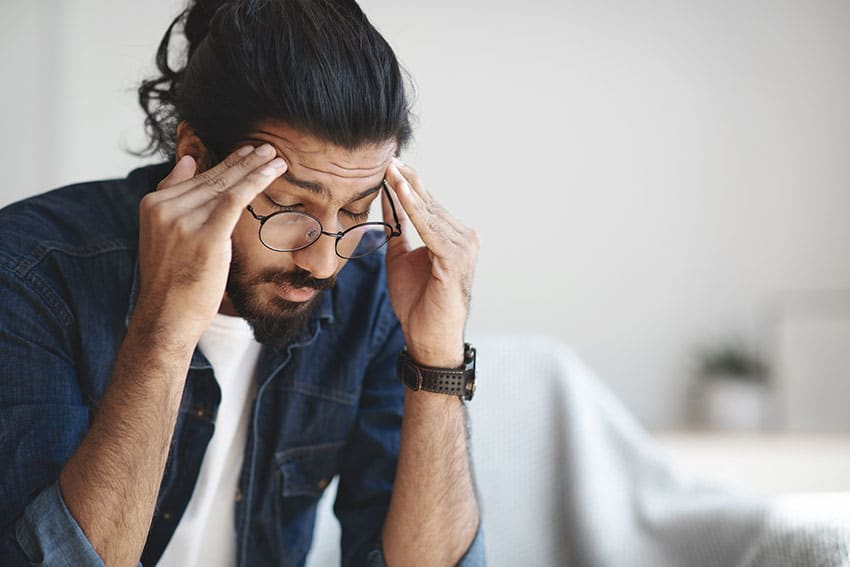 hip young man suffering from headache